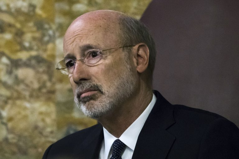 Gov. Tom Wolf listens as Pennsylvania lawmakers come together in an unusual joint session to commemorate the victims of the Pittsburgh synagogue attack that killed 11 people last year at the state Capitol in Harrisburg, Pa. (Matt Rourke/AP Photo)