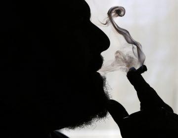 In this Nov. 21, 2014 file photo, a man smokes medical marijuana at his home in Belfast, Maine. (Robert F. Bukaty/AP Photo)