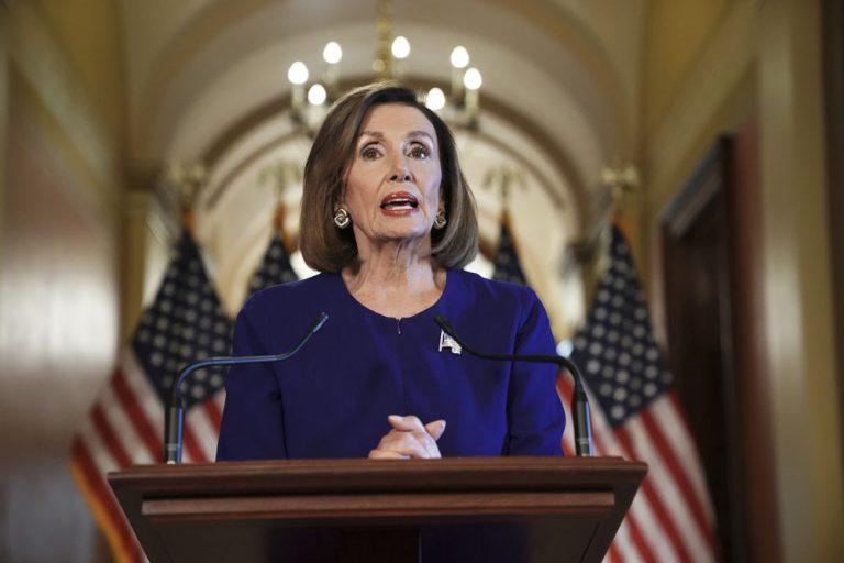 House Speaker Nancy Pelosi stands at a podium