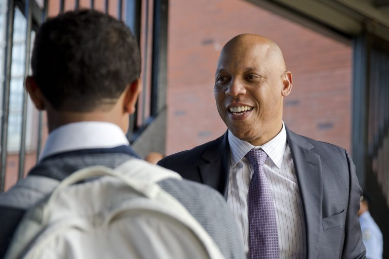 In this file photo, Superintendent William Hite meets with a student outside of a high school, Monday, Sept. 8, 2014, in Philadelphia. (Matt Rourke/AP Photo)