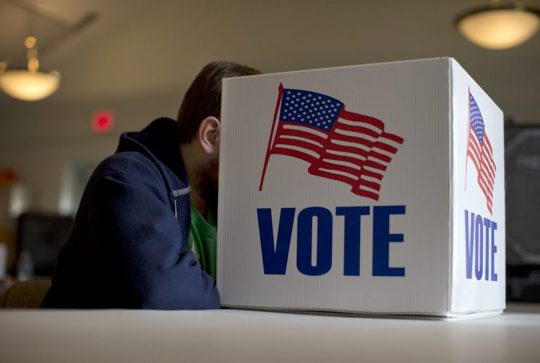 A voter fills out a provisional ballot by hand for the midterm elections at a polling place in Annapolis, Md., Tuesday, Nov. 4, 2014. (Carolyn Kaster/AP Photo)