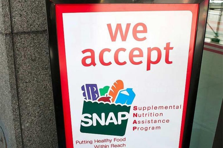 A sign indicates a store that accepts the Supplemental Nutritional Assistance Program or SNAP, the official name of the food stamp program. (File photo/The Columbus Dispatch/TNS)