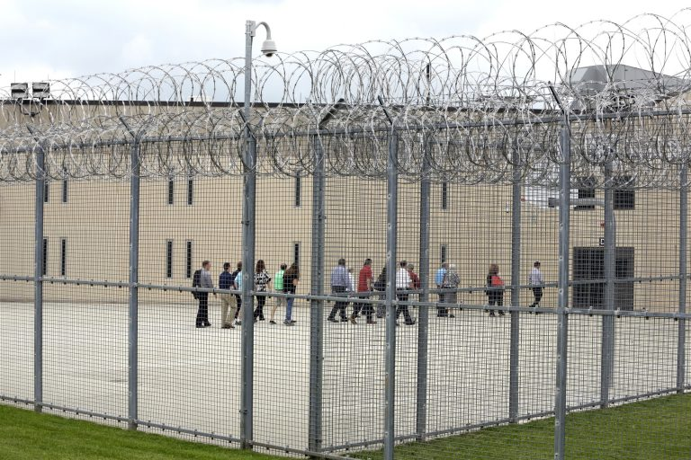 In this June 1, 2018, file photo, people walk on a tour of the West section of the State Correctional Institution at Phoenix in Collegeville, Pa. (AP Photo/Jacqueline Larma, File)
