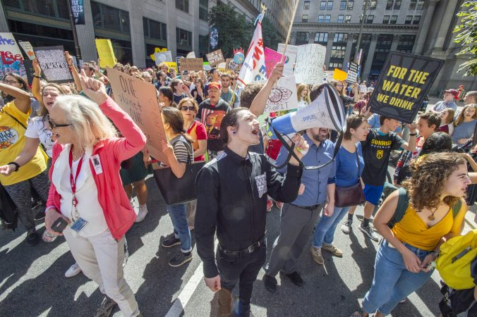 Protesters stopped on the east side of City Hall to chant for elected officials inside the building. (Jonathan Wilson for WHYY)