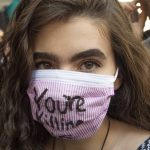 A protester wears a mask at the Climate Strike. Jonathan Wilson for WHYY