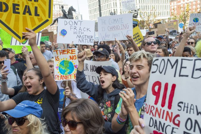 Thousands of students and their supporters cheer on speakers at the climate strike on the north side of City Hall. (Jonathan Wilson for WHYY)