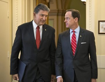 In this April 10, 2013 file photo, Sen. Joe Manchin, D-W.Va. (left) and Sen. Patrick Toomey, R-Pa. arrive for a news conference on Capitol Hill in Washington to announce that they have reached a bipartisan deal on expanding background checks to more gun buyers. (AP Photo/J. Scott Applewhite, File)