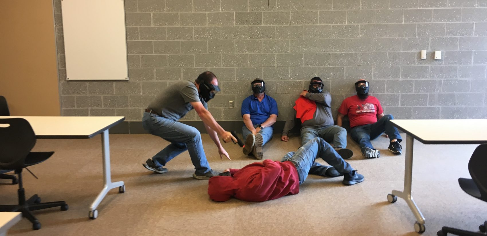 Teachers practice responding to active shooter scenarios at a high school in Ohio. Cerino tells the trainees pretending to be students,