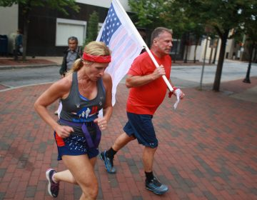 Runners head through downtown Wilmington on their way from the Pentagon to Ground Zero in New York City as part of the 243-mile 9/11 Promise Run. (Mark Eichmann/WHYY)