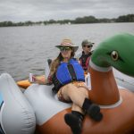 Erica Baugh of Upstream Alliance floats on the Delaware River in Pyne  Poynt Park in Camden, N.J. (Miguel Martinez for WHYY)