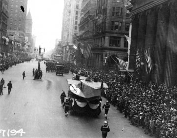 A Naval Aircraft Factory float, featuring the hull of a F5L patrol seaplane, heads south on Broad Street in Philadelphia, escorted by sailors with rifles. Note the crowd of onlookers. This parade, with its associated dense gatherings of people, contributed significantly to the massive outbreak of influenza which struck Philadelphia a few days later. (NH 41730 courtesy of the Naval History & Heritage Command)