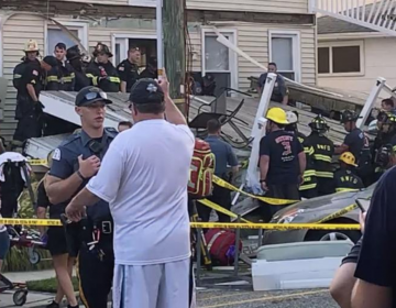 In this photo provided by James Macheda, first responders work the scene of a building structure damage in Wildwood, N.J., Saturday, Sept. 14, 2019. Multiple levels of decking attached to a building collapsed Saturday evening at the Jersey Shore, trapping people and injuring several, including children, officials and witnesses said. (James Macheda via AP)