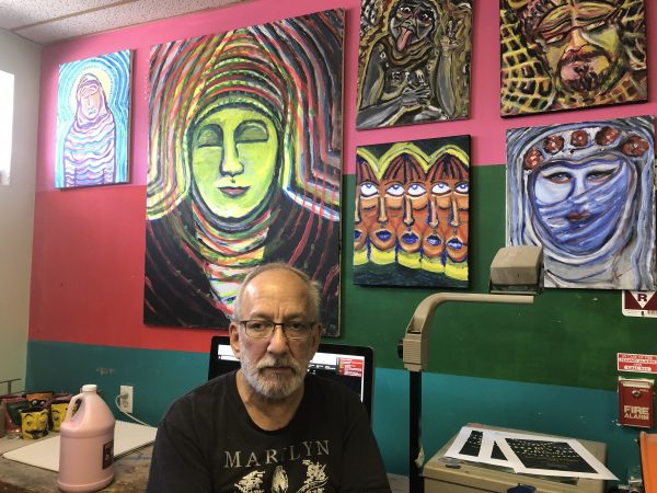 Kenneth Segal was once a member and now is on staff. He sells many of his paintings.           (Cris Barrish/WHYY)