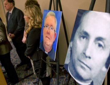 A photograph of the Rev. Robert L. Brennan is displayed during a news conference Wednesday, Nov. 13, 2013, in Philadelphia.  (AP Photo/Matt Rourke)