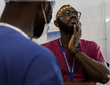 Orthopedic surgeon Kebba Marenah and his team get ready to perform knee surgery on a 14-year-old at the Edward Francis Small Teaching Hospital in Banjul, the capital of Gambia. The country struggles with a lack of access to sufficient pain medications. (Samantha Reinders for NPR)