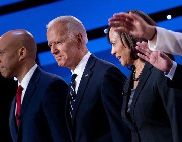 Democratic presidential hopefuls (from left): Sen. Cory Booker, D-N.J., former Vice President Joe Biden, and Sen. Kamala Harris, D-Calif., onstage before the July debate. (Brendan Smialowski/AFP/Getty Images)