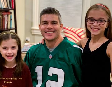 The author and his daughters, who are also both Eagles fans COURTESY JOHN TRUITT
