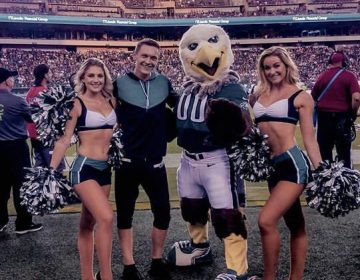 Kyle Tanguay, Swoop and two other members of the Eagles cheer squad (Twitter / @ktangkyle)