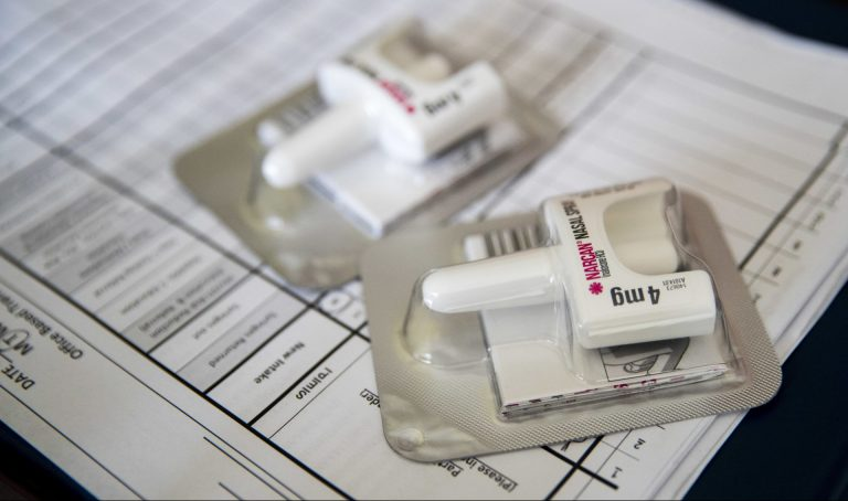 A Narcan nasal device, which delivers naloxone, lies on a counter. (Mary Altaffer/AP Photo)