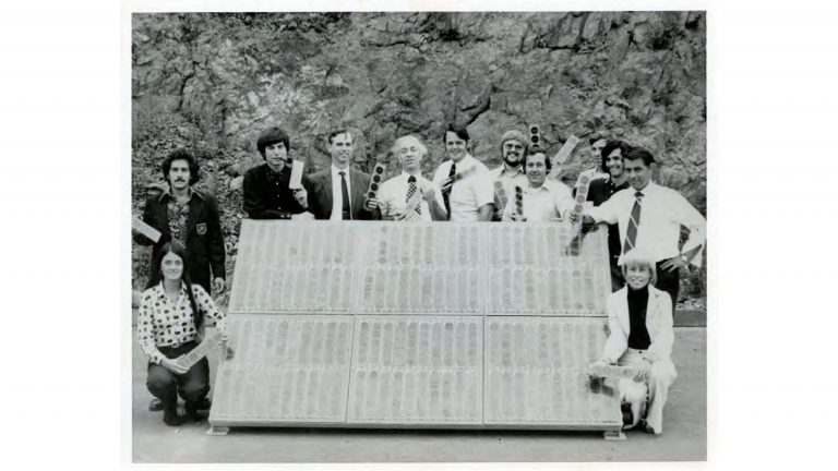 Elliot Berman (center, in patterned tie) and his team at Solar Power Corp. pose outside their office and manufacturing facility in Braintree, Mass., in 1973. John Perlin, author of Let It Shine: The 6,000-Year Story of Solar Energy, credits Berman, Solar Power Corp. and Exxon with