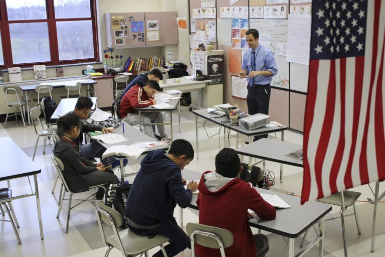 FILE PHOTO: In this Feb. 15, 2017, photo, Eric Hoover teaches his class of immigrant and refugee students at McCaskey High School in Lancaster, Pa. (Michael Rubinkam/AP Photo)