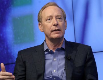 Microsoft President Brad Smith says governments need to set rules for big technology companies.