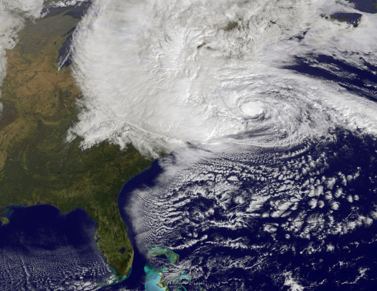 Scientists have been studying the link between climate change and extreme weather events such as Hurricane Sandy, shown here in a NASA image, which left more than 1.3 million Pennsylvanians in the dark in 2012. (Getty Images)