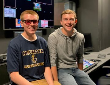 A Neumann University student videographer was surprised during a live newscast with color-corrective glasses purchased by his classmates. (Courtesy of Neumann Media)