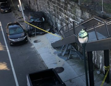 A chevy smashed into the Rail Park steps on Tuesday after the driver had a seizure. COURTESY JOHN PETTIT