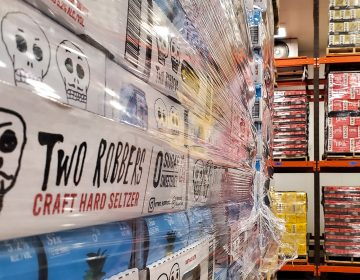 Stacks of Two Robbers hard seltzer in the Yards Brewing walk-in (Mark Henninger/for Billy Penn)
