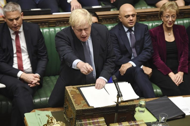 Britain's Prime Minister Boris Johnson speaks to lawmakers inside the House of Commons to update details of his new Brexit deal with EU, in London. Secretary of State for Exiting the European Union, Stephen Barclay, left, and Business Secretary Andrea Leadsom, right. (Jessica Taylor/AP)