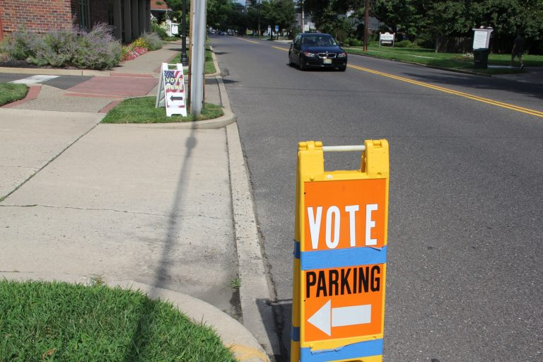 Signs point voters to a polling place in Moorestown, New Jersey. (Emma Lee/WHYY)