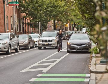 A cyclist rides down a bike lane in Philadelphia