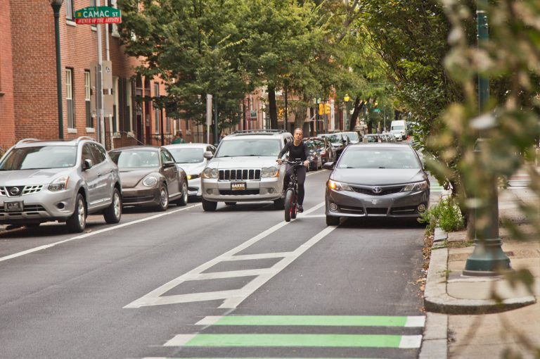 Despite making bike lanes more visible, cars are still blocking them. (Kimberly Paynter/WHYY)