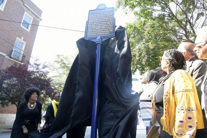 Officials and community leaders unveil the state historical marker for the Mother Bethel AME Burying Ground. (Bastiaan Slabbers for WHYY)