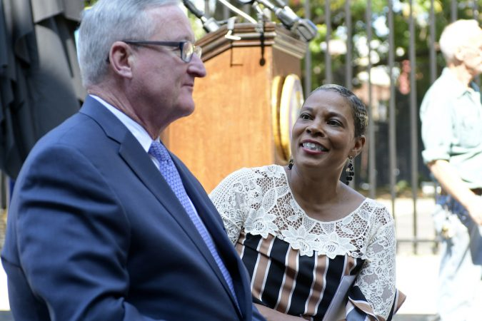Mayor Jim Kenney and the city's Chief Cultural Officer Kelly Lee at the unveiling of a historical marker for the Mother Bethel AME Burying Ground. (Bastiaan Slabbers for WHYY)