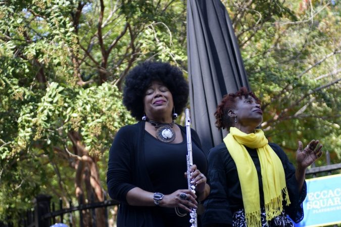 Ruth Naomi Floyd and Valerie Gay perform ahead of the unveiling of a state historical marker at the Mother Bethel AME Burying Grounds. (Bastiaan Slabbers for WHYY)