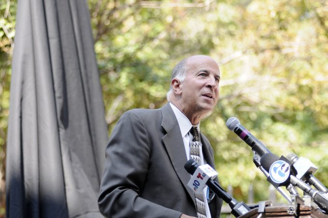 Councilmember Mark Squilla speaks ahead of the unveiling of a state historical marker at the Mother Bethel AME Burying Ground, in Queen Village, on Tuesday. (Bastiaan Slabbers for WHYY)