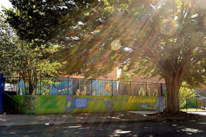 Four-foot-high fences surround parts of Lewis Elkin Elementary School in Kensington. (Bastiaan Slabbers for WHYY)