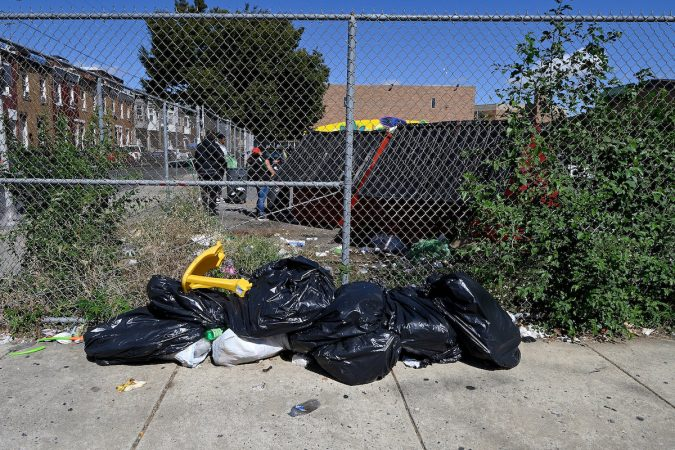 Human feces, trash and drug-related items are found outside the Lewis Elkin Elementary School campus. (Bastiaan Slabbers for WHYY)