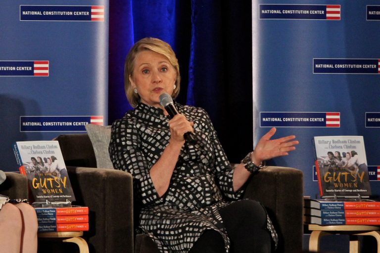 Hillary Clinton takes a moment to talk about impeachment during a talk promoting the book she wrote with daughter Chelsea Clinton. The two appeared at the National Constitution Center before a sold out crowd of 650. (Emma Lee/WHYY)