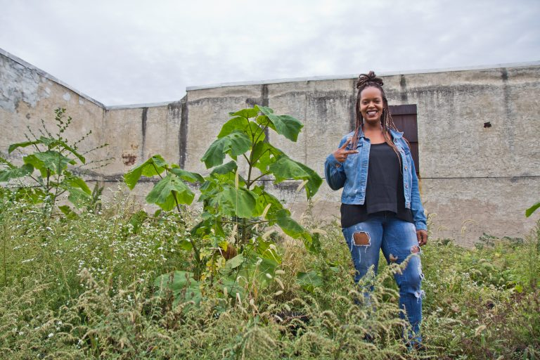 Rashida Ali-Campbell on her lot on N 41st St. (Kimberly Paynter/WHYY)