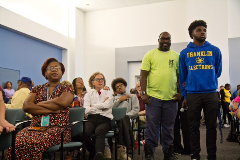 At the School District headquarters on  Monday morning, parents and students at a packed meeting discuss the closures of Ben Franklin and Science Leadership Academy high schools because of asbestos remediation. (Kimberly Paynter/WHYY)