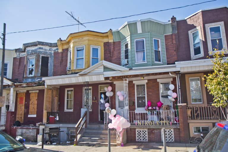 A 2 year-old was killed on Water Street in Kensington when a gunman shot through the front windows into her family's living room (Kimberly Paynter/WHYY)