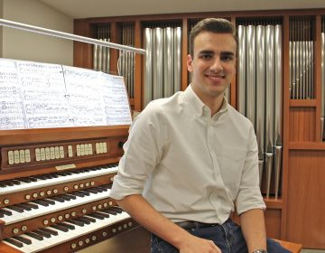 Adrian Binkley, an student at the Curtis Institute of Music in Philadelphia, has been surveying church pipe organs in churches outside Center City. (Emma Lee/WHYY)