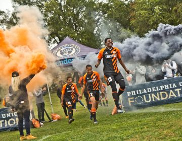 The Chester High School soccer team takes the field for their first home game in over 30 years. (Kimberly Paynter/WHYY)