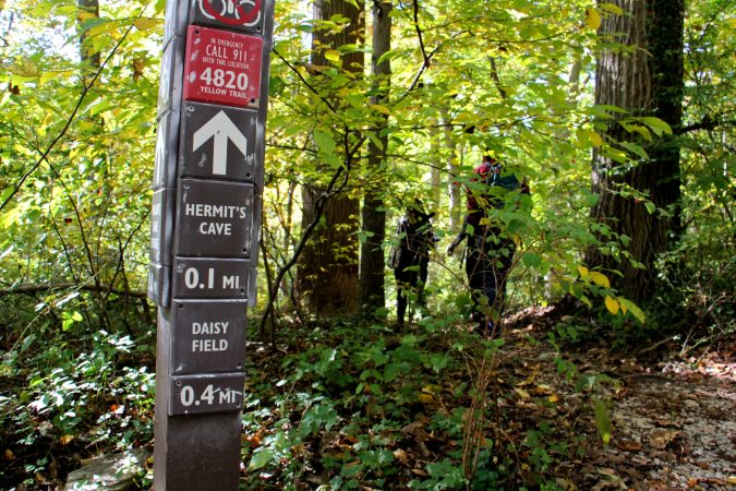 A trail marker points in the direction of the Hermit's Cave, believed to have been used by Johannes Kelpius and his followers  while they awaited the end of days in the wilderness. (Emma Lee/WHYY)