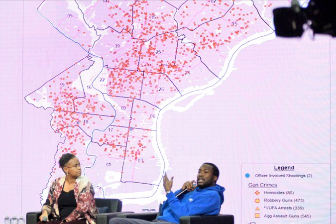 A map of gun crimes is show on the stage during the Players Coalition Town Hall on Policing in the city, at Community College of Philadelphia, on Monday. (Bastiaan Slabbers for WHYY)