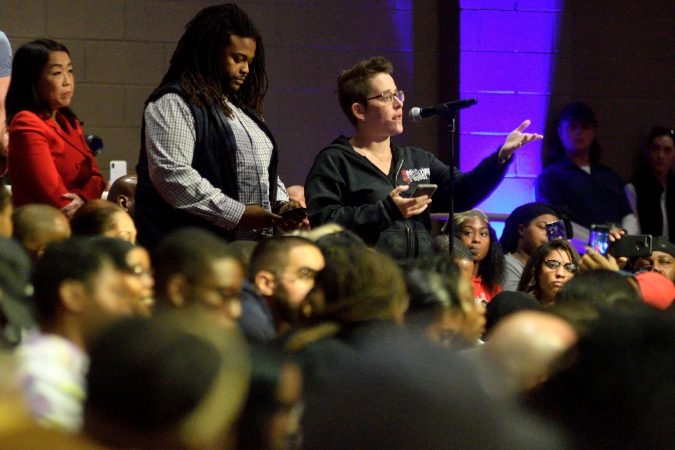 Audience members field questions for panelist on stage during the Players Coalition Town Hall on Policing in the city, at Community College of Philadelphia, on Monday. (Bastiaan Slabbers for WHYY)