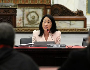 City Councilmember Helen Gym speaks at a city council meeting. (Emma Lee/WHYY)